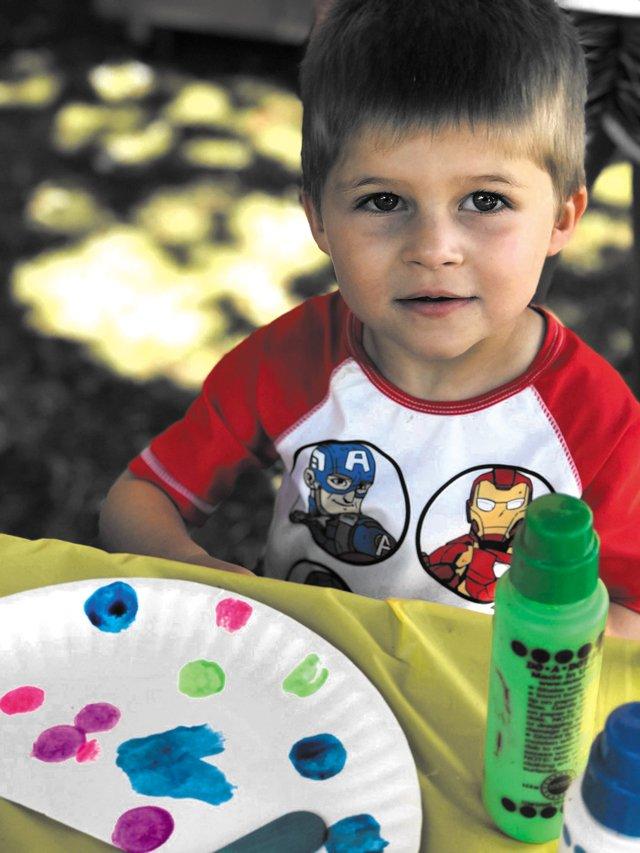 Cute-boy-with-paint-cmyk.jpg