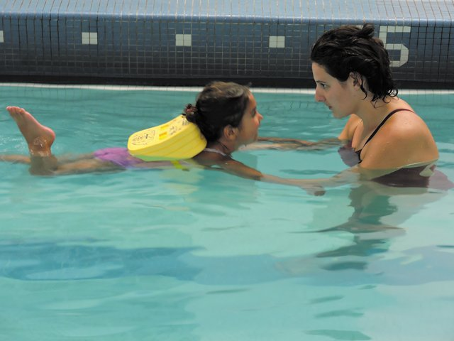 Adult-teaching-swimming-cmyk.jpg