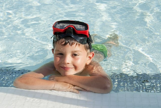 Boy In Swimming Pool