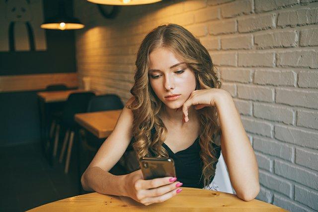 Sad Teen with Phone.jpg