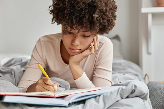 Teen Writing in Journal.jpg
