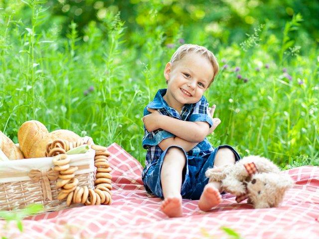 little-cute-boy-sits-plaid-plays-with-his-teddy-bear.jpg
