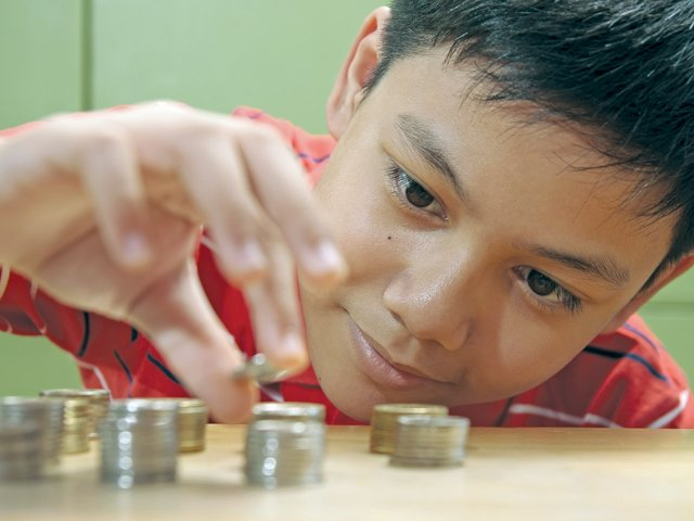 Boy-Stacking-Coins.jpg