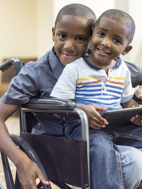Brothers in Wheelchair